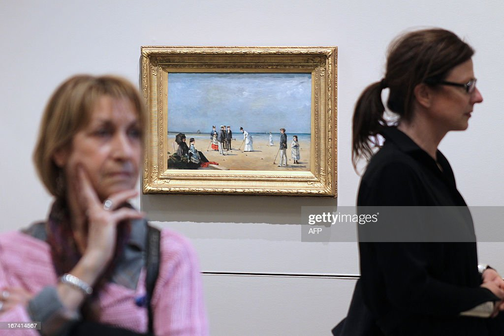 People stand by the painting 'Partie de croquet sur la plage du Tréport' by Louise Abbema, three days before the opening of 'Normandie Impressionniste' at Caen's fine arts museum, on April 24, 2013. The exhibition which takes place in Caen is one of the three most important, with the ones of Le Havre and Rouen, which are 'National interest' labelized. Caen's exhibition gathers 67 art paintings including 34 from abroad. This exhibition (in Rouen, Caen and Le Havre) begins on April 27 to September 29.