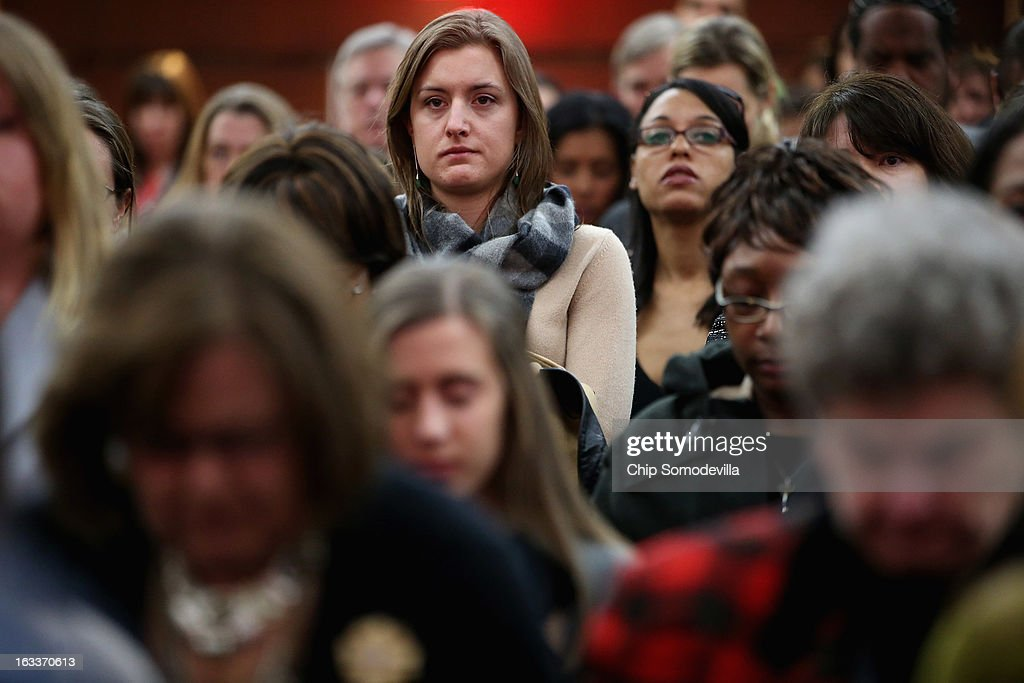 People stand for a moment of silence for the 23-year-old Indian woman known only as 'Nirbhaya,' who died from injuries she received after being gang raped by six men last December in Delhi, during the International Women of Courage awards ceremony at the State Department March 8, 2013 in Washington, DC. In celebration of the 102nd International Women's Day, the State Department honored nine women from around the world with the International Women of Courage Award, including 'Nirbhaya'.