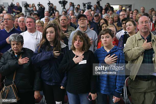 People stand for the Pledge of Allegiance before the arrival of Republican presidential candidate Sen Marco Rubio at a campaign town hall event at...