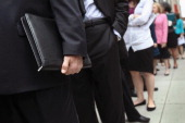 People stand in a line that stretched around the block to enter a job fair held at the Jewish Community Center on March 21 2012 in New York City More...