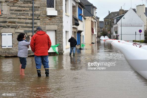 people stand in a street in pontivy northwestern france flooded by the rising waters of the. Black Bedroom Furniture Sets. Home Design Ideas