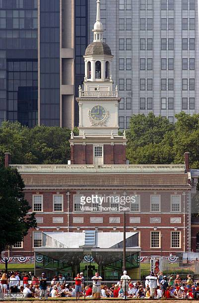 People stand in front of Independence Hall trying to catch a glimpse as the 2003 Liberty Medal is presented to Supreme Court Justice Sandra Day...