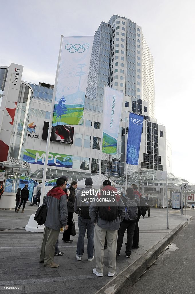 People stand in front of Main Press Center at Vancouver harbour on February 6 2010 ahead of the Vancouver 2010 Olympics Winter Olympic host city...