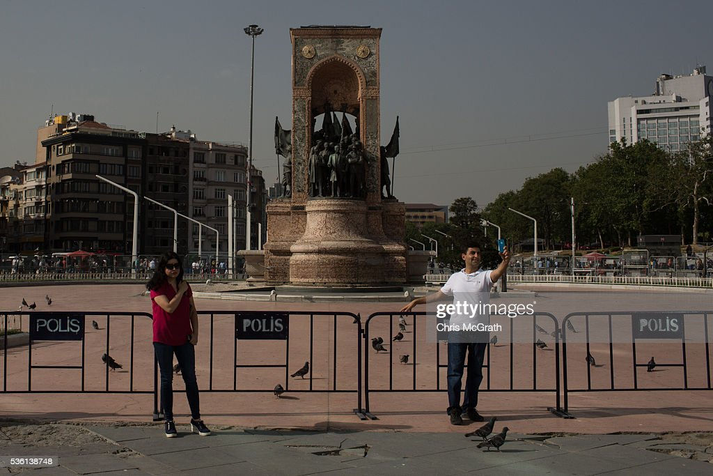 People stand in front of police barricades surrounding Taksim Square and Gezi Park on the third anniversary of the Gezi Park protests on May 31, 2016 in Istanbul, Turkey. The protests began on May 28, 2013 to contest the planned urban development of Gezi Park, however larger protests started after police evicted protesters from the park sparking weeks of civil unrest.