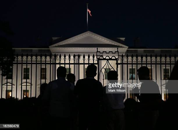People stand in front of the White House on eve of a possible government shut down September 30 2013 in Washington DC If House Republicans do not...