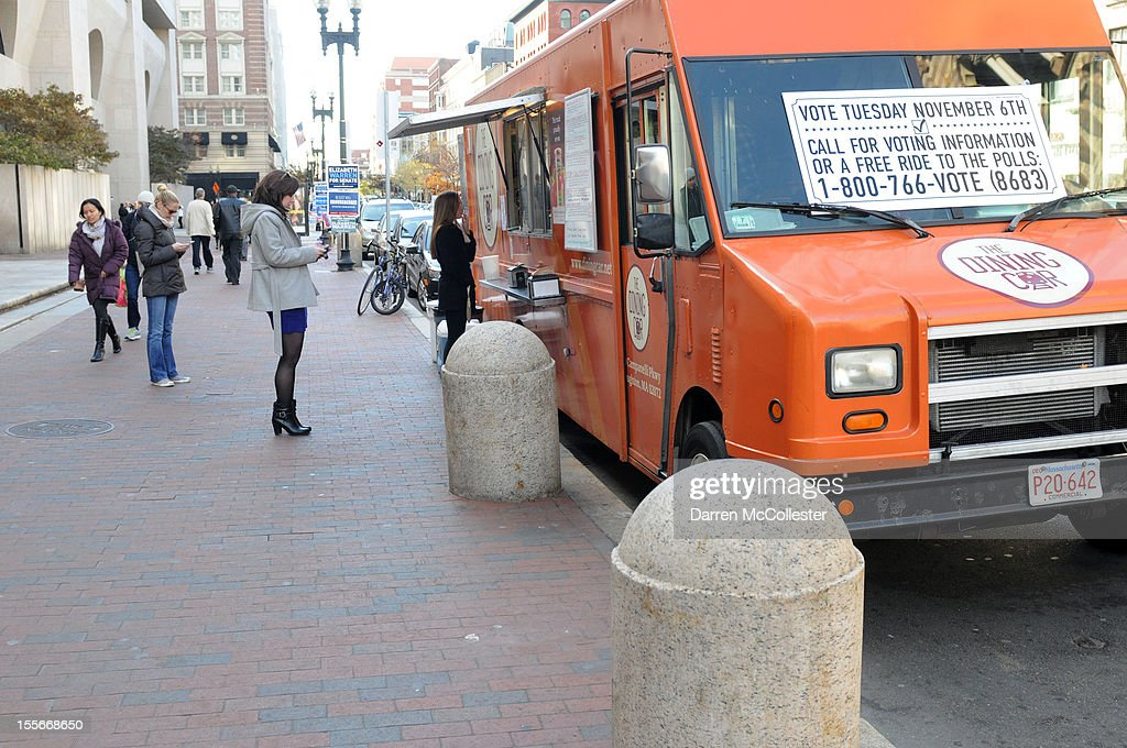 People stand in line at a lunch truck outside a voting station on Boylston Street November 6, 2012 in Boston, Massachusetts. The race between incumbent President Barack Obama and Republican challenger Mitt Romney will come down to certain swing states like New Hampshire. Photo by Darren McCollester/Getty Images)
