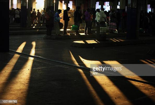People stand in line at the Bree taxi rank in Johannesburg on June 7 2010 Johannesburg the showpiece venue for the first ever World Cup on African...