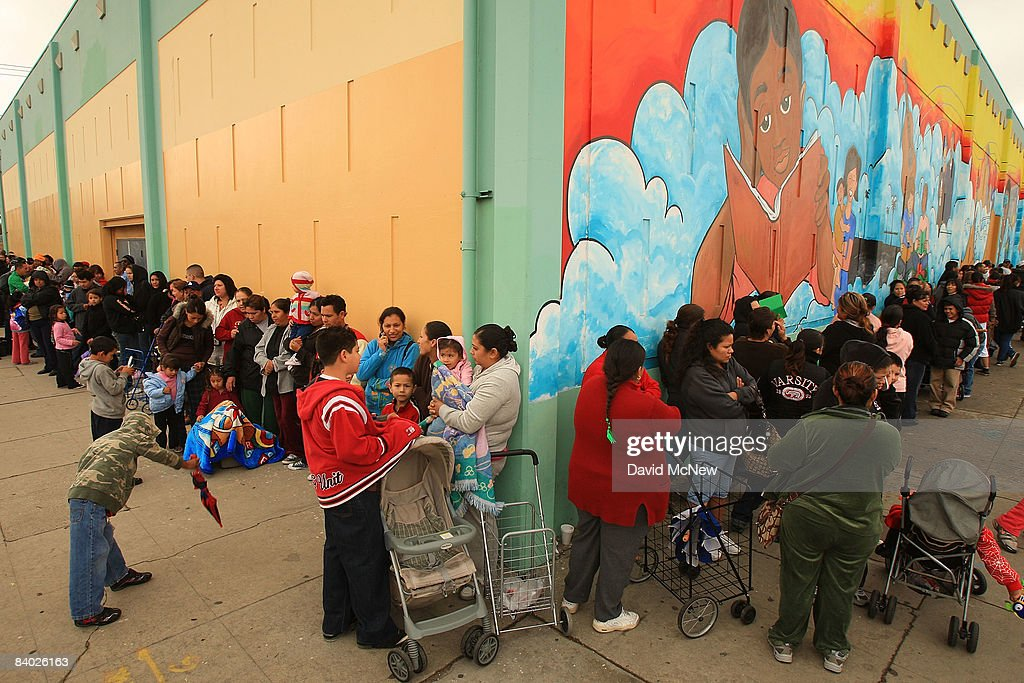 People stand in line for hours to receive gifts of food, personal care and household items and toys at the Miracle in South Central event, part of the nationwide Miracle on Main Street, USA program to help working poor and disadvantaged families, on December 13, 2008 in the South Central neighborhoods of Los Angeles, California. About 5,000 families are expected to receive enough food at the event to supplement meals for a family of four for a week. Miracle on Main Street, USA is sponsored by The National Basketball Players Association (NBPA) along with Feed The Children, Feed 333, Humanity Unites Brilliance (HUB) and hosted by the Salvation Army.