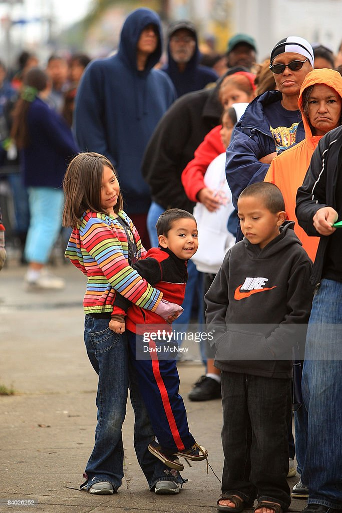 People stand in line for hours to receive gifts of food, personal care and household items and toys at the Miracle in South Central event, part of the nationwide Miracle on Main Street, USA program to help working poor and disadvantaged families on December 13, 2008 in the South Central neighborhoods of Los Angeles, California. About 5,000 families are expected to receive enough food at the event to supplement meals for a family of four for a week. Miracle on Main Street, USA is sponsored by The National Basketball Players Association (NBPA) along with Feed The Children, Feed 333, Humanity Unites Brilliance (HUB) and hosted by the Salvation Army.