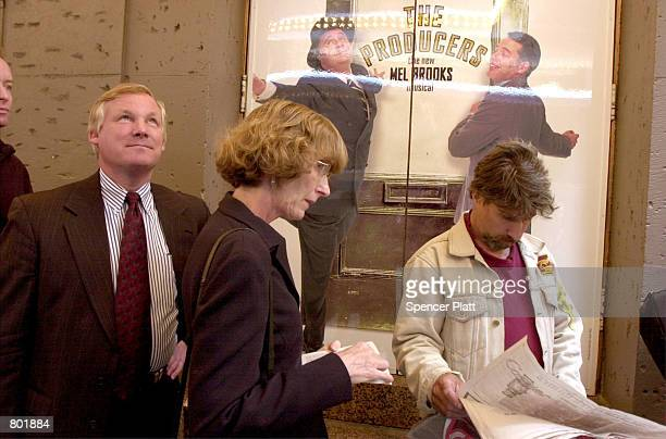 People stand in line outside the St James Theatre in New York April 25 2001 to purchase tickets for the Broadway production of 'The Producers' 'The...