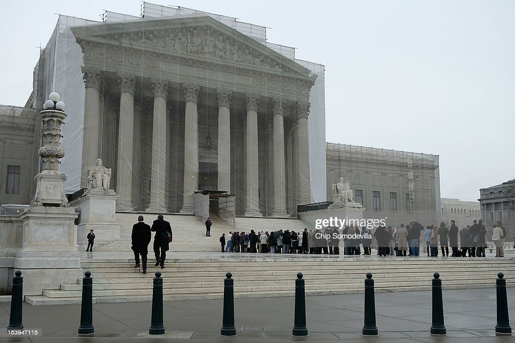 People stand in line outside U.S. Supreme Court for a chance to hear oral arguements in the case Arizona v. Inter Tribal Council et al. March 18, 2013 in Washington, DC. The court is being asked to deterimine the constitutionality of an Arizona law that requires people to provide documents proving their citizenship before registering to vote under the federal National Voter Registration Act.