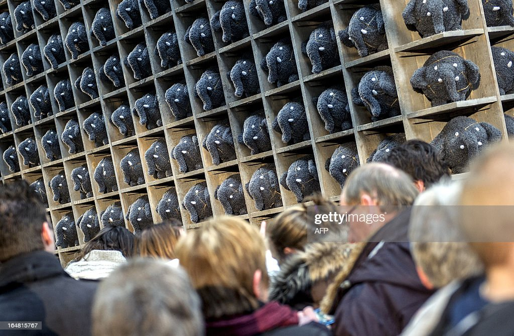 People stand in line to buy stuffed puppets representing elephants called Olli in Rotterdam, The Netherlands, on March 28, 2013. Olli, together with former Feyenoord Rotterdam football player Giovanni van Bronckhorst, stars in a popular Dutch TV commercial about Blijdorp Zoo recently becoming the jersey sponsor of the Rotterdam club. netherlands out