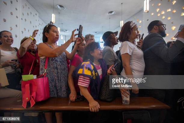 People stand in line to meet US Senator Kamala D Harris during a town hall at Holman United Methodist Church on April 21 2017 in Los Angeles...