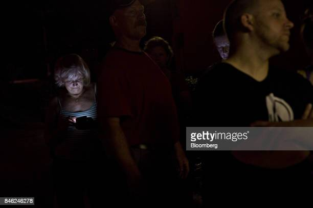 People stand in line to order food at the drive through window of an Arby's restaurant in Estero Florida US on Tuesday Sept 12 2017 Seven million...
