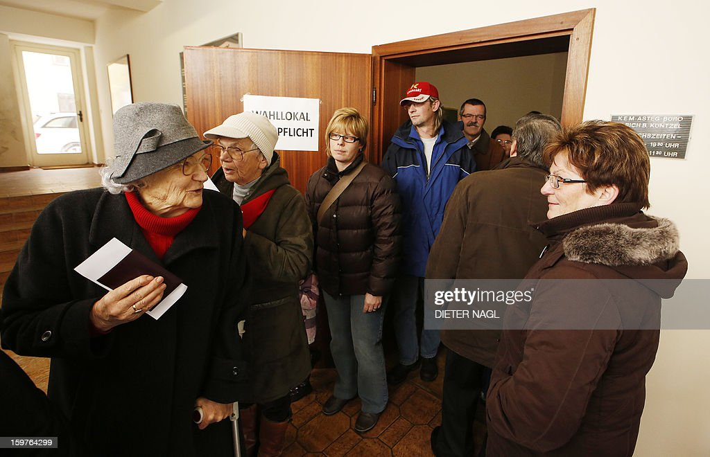 People stand in line to vote for the future of the Austrian Army at a polling station in Allenstein, near Vienna, Austria on January 20, 2013. Opinion polls indicate that Austrians will decide Sunday in a referendum to remain one of the very few countries in Europe with compulsory military service.