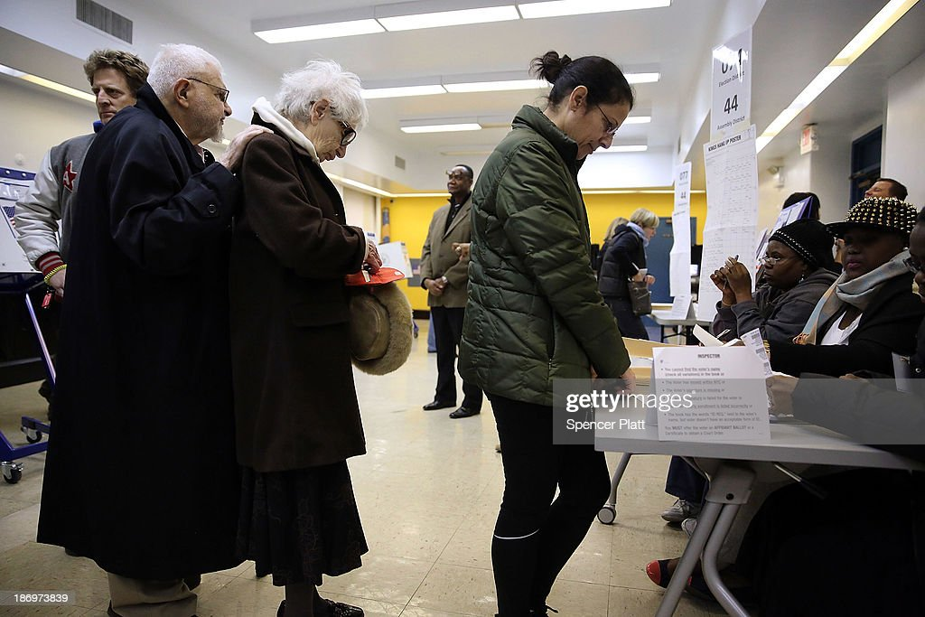 People stand in line to vote on Election Day on November 5, 2013 in the Brooklyn borough of New York City. New York Democratic mayoral candidate Bill de Blasio is running against Republican mayoral candidate Joe Lhota in a highly anticipated mayoral campaign.