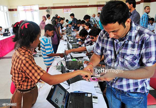 People stand in queue during Aadhar card camp pilot project for authentication of UID cards at Mayur Vihar Phase 2 on July 24 2012 in New Delhi India