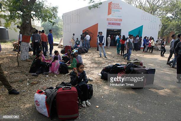 People stand in queue for registration at 102nd Indian Science Congress at Kalina University on January3 2015 in Mumbai India The 102nd Indian...