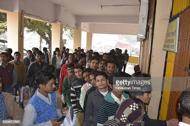 People stand in queue outside the Allahabad Bank at Navyug market on December 29 2016 in Ghaziabad India As 50 days to deposit old notes promised by...