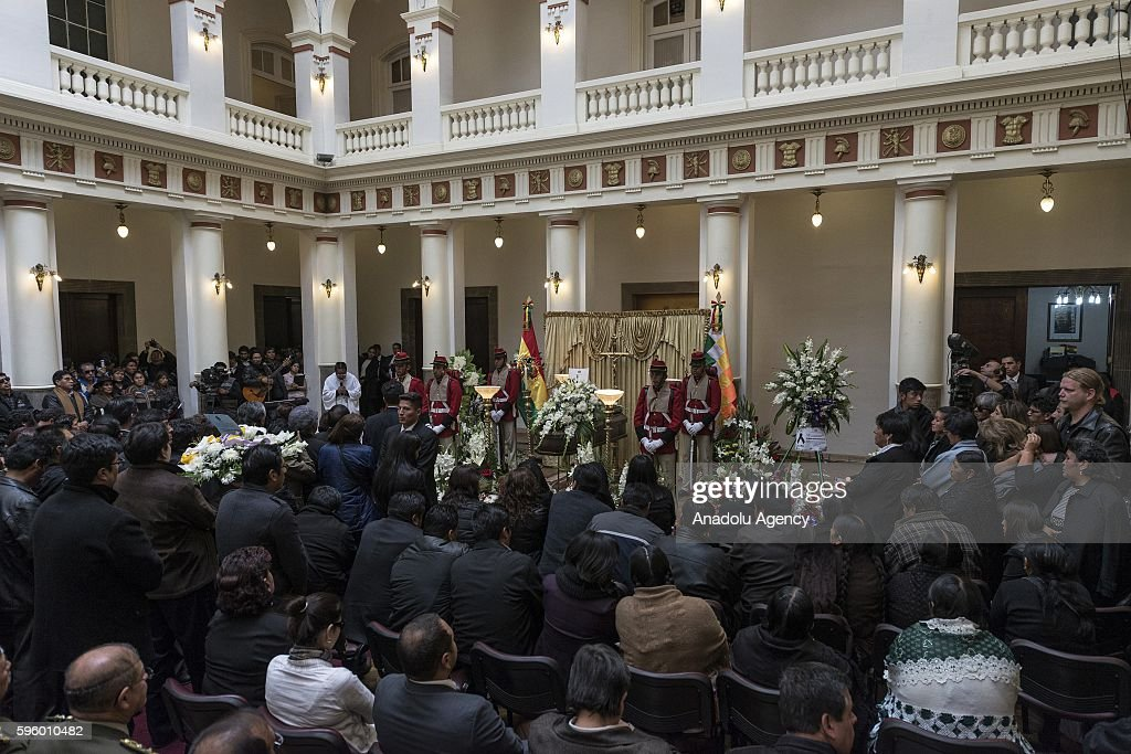 People stand in silence during the wake of Bolivian Deputy Interior Minister Rodolfo Illanes at the presidential Quemado Palace in La Paz Bolivia on...