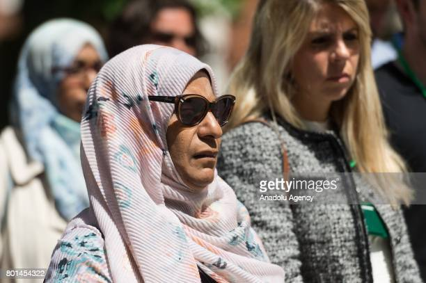 People stand in silence for the victims of the Finsbury Park terrorist attack outside Islington Town Hall in London United Kingdom on June 26 2017...