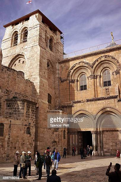 People stand in the courtyard of the Church of the Holy Sepulchre on November 29 2014 in Jerusalem Israel The church is said to be where Jesus was...