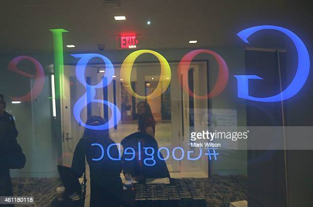 People stand in the lobby of Google's Washington headquarters January 8 2015 in Washington DC Google held a news conference with Right4Girls and the...
