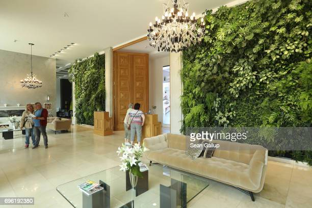 People stand in the lobby of the completed Prora Solitaire hotel in Block 2 of the Prora building complex on Ruegen Island on June 14 2017 in Binz...