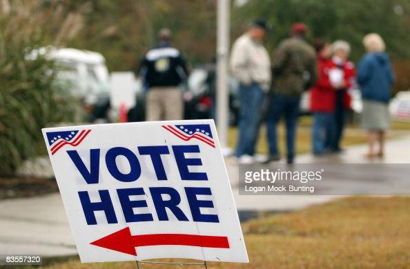 People stand in the rain at a polling place November 4 2008 in Currie North Carolina After nearly two years of presidential campaigning US citizens...
