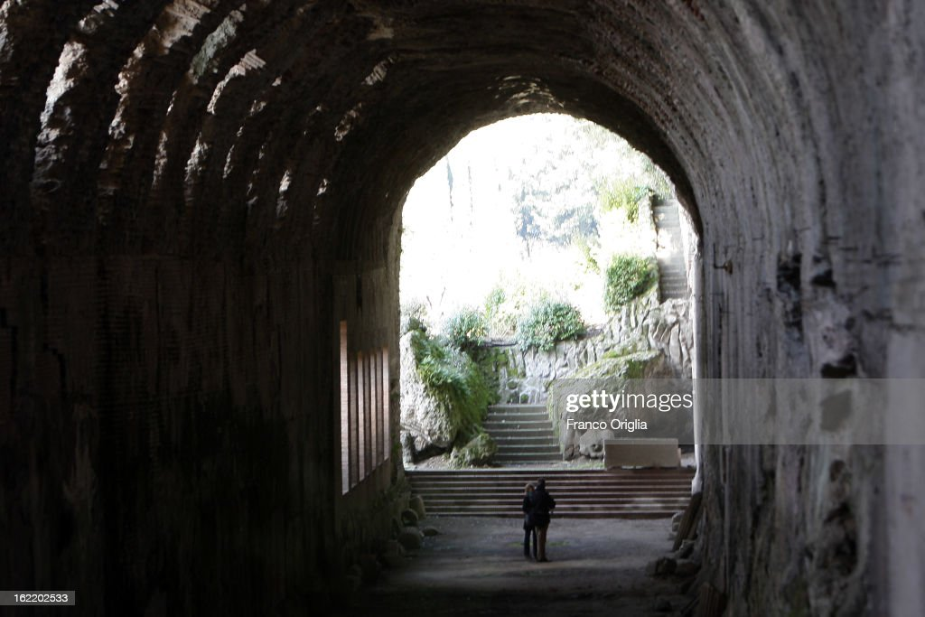 People stand in the Roman catacombs in the gardens of the Pontifical residence of Castelgandolfo on February 20, 2013 in Rome, Italy. The Apostolic Palace and The Ponifical Villas of Castelgandolfo, 10 miles south Rome, are the summer residence of Popes and will host Pope Benedict XVI during the next conclave.