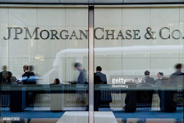 People stand inside the lobby of the JPMorgan Chase Co headquarters building in New York US on Thursday April 10 2014 JPMorgan Chase Co is scheduled...