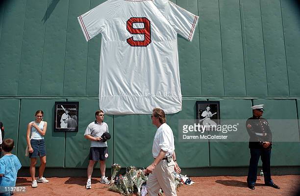 People stand near a replica Ted Williams' jersey during 'Ted Williams A Celebration of an American Hero' day July 22 2002 at Fenway Park in Boston...
