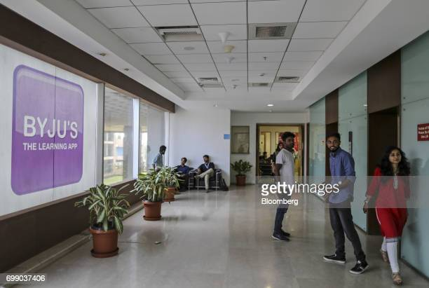 People stand near elevators in the Think and Learn Pvt office in Bengaluru India on Wednesday April 5 2017 Online learning is exploding in India and...