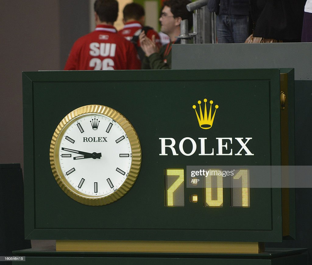 People stand next to a board bearing the time of the longest Davis Cup rubber of all time in Geneva. The Czech Republic's Tomas Berdych and Lukas Rosol defeated Stanislas Wawrinka and Marco Chiudinelli of Switzerland 6-4, 5-7, 6-4, 6-7 (3/7), 24-22. The result surpassed the previous record in the history of the tournament of the 6 hours 22 minutes it took John McEnroe to beat Mats Wilander 9-7, 6-2, 15-17, 3-6, 8-6 in the tie between the United States and Sweden in 1982.