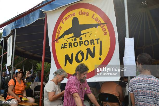 People stand next to a sign reading 'Airport no' during a twoday meeting organised by opponents to a controversial international airport project in...