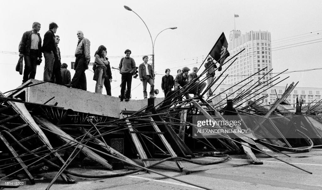People stand on a barricade in front the Russian White House in Moscow on August 21 1991 Russia marks on August 1922 the 20th anniversary of the...