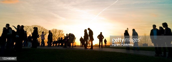 People stand on Primrose Hill, London