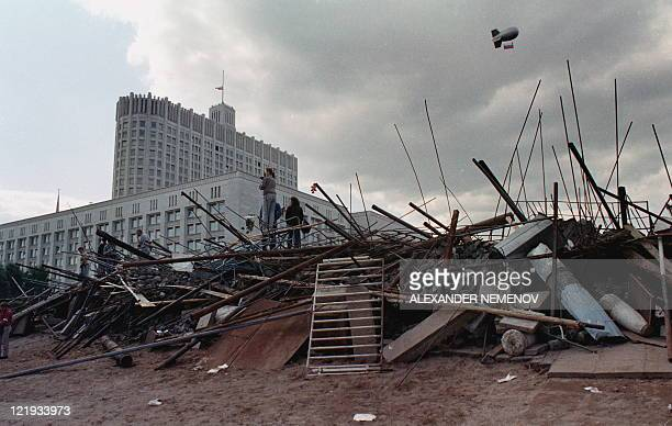People stand on the barricades surrounding the Russian White House in Moscow on August 24 1991 Russia marks on August 1922 the 20th anniversary of...