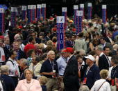 People stand on the floor before the start of day one of the Republican National Convention at the Xcel Energy Center September 1 2008 in St Paul...