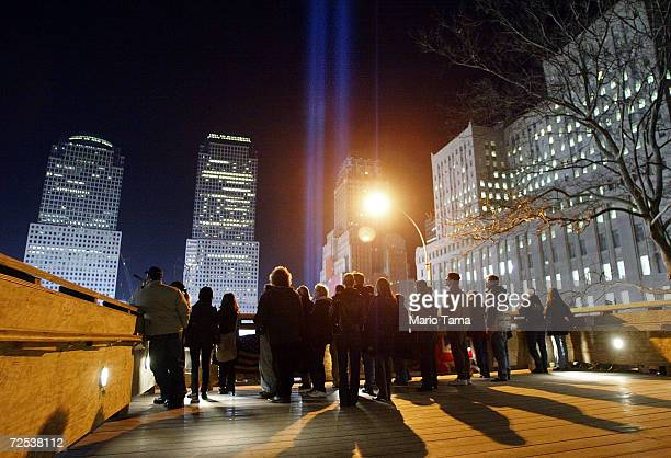 People stand on the Ground Zero viewing platform beneath the 'Tribute in Light' memorial on the sixmonth anniversary of the World Trade Center...