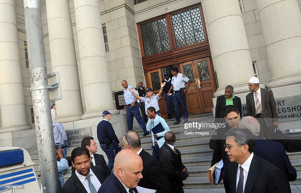 (SOUTH AFRICA OUT People stand on the pavement outside The High Court following a bomb scare at the Cape Town High Court on November 21, 2012 in Cape Town, South Africa. This disrupted the sentencing of Mngeni who was found guilty of robbery with aggravating circumstances, premeditated murder and illegal possession of a firearm and ammunition, after his involvement with the murder of Anni Dewani, allegedly plotted by her British husband Shrien Dewani.