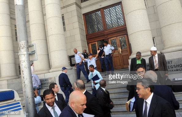SOUTH AFRICA OUT People stand on the pavement outside The High Court following a bomb scare at the Cape Town High Court on November 21 2012 in Cape...