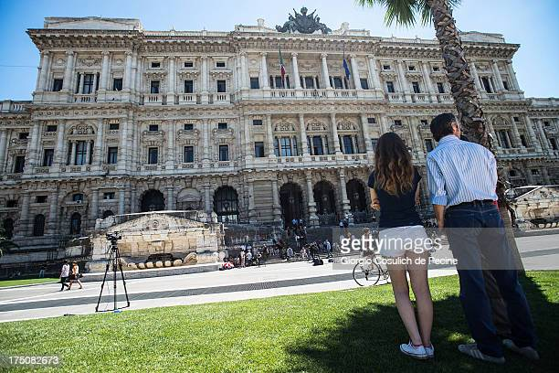 People stand outide of the 'Corte di Cassazione' or Supreme Court during the final arguments as former Italian Prime Minister Silvio Berlusconi seeks...