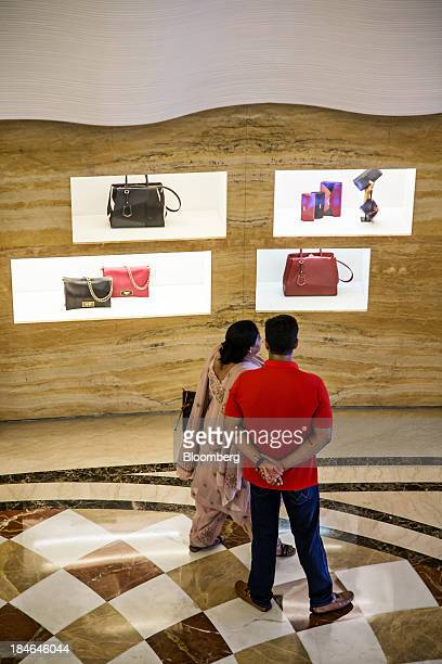 People stand outside a Fendi store a brand of LVMH Moet Hennessy Louis Vuitton SA at the DLF Emporio shopping mall in New Delhi India on Thursday Oct...
