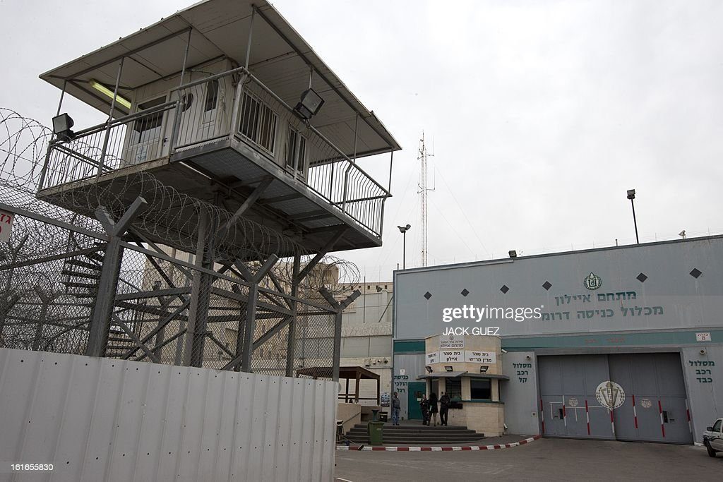People stand outside Israeli Ayalon prison in Ramle near Tel Aviv on February 14, 2013. Israel has confirmed it jailed a foreigner in solitary confinement on security grounds who later committed suicide, as Australia admitted it knew one of its citizens had been secretly held. AFP PHOTO / JACK GUEZ