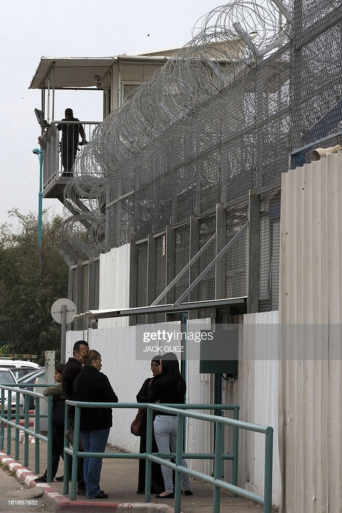 People stand outside Israeli Ayalon prison in Ramle near Tel Aviv on February 14, 2013. Israel has confirmed it jailed a foreigner in solitary confinement on security grounds who later committed suicide, as Australia admitted it knew one of its citizens had been secretly held.
