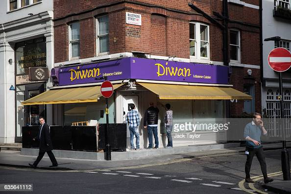 People stand outside of a closed Lebanese restaurant in Marylebone is pictured on February 16 2017 in London England The Association for Licensed...