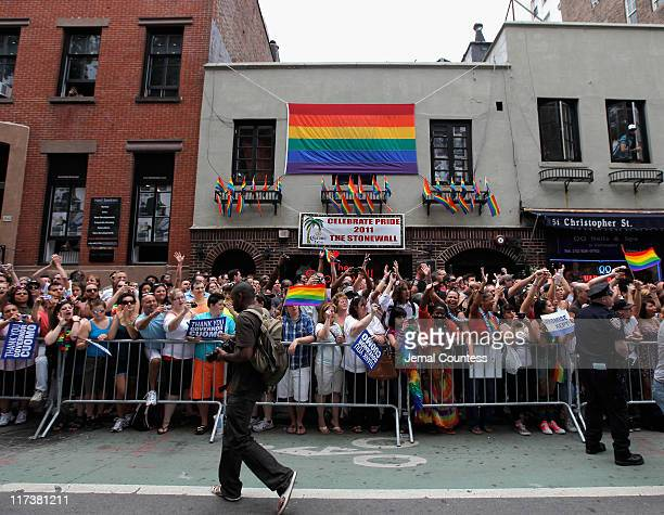 People stand outside of The Stonewall Inn during the 2011 NYC LGBT Pride March on the streets of Manhattan on June 26 2011 in New York CityThousands...