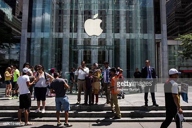 People stand outside the Apple Store on Fifth Avenue on August 5 2015 in New York City Analysts at Bank of America Merrill Lynch recently changed...