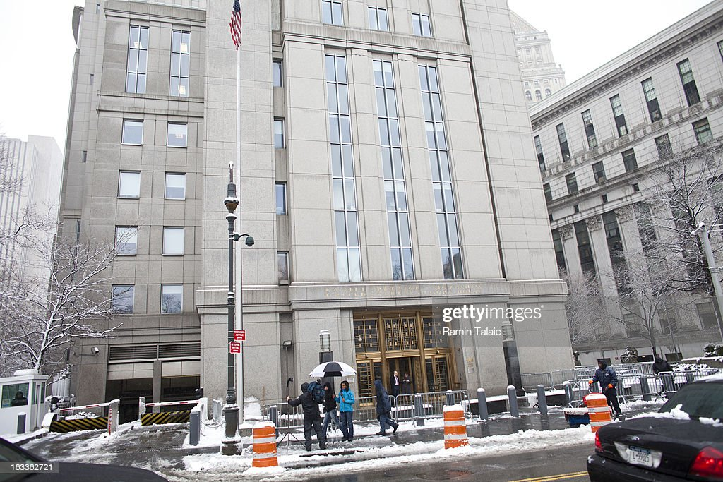 People stand outside the Daniel Patrick Moynihan United States Court House where Sulaiman Abu Ghaith was arraigned on March 8, 2013 in New York City. Abu Ghaith, a son-in-law of Osama bin Laden and former associate, plead not guilty at his arraignment on charges of conspiracy to kill Americans.